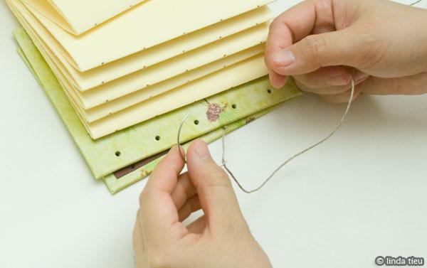 koptische binding - eerste katern aan kaft naaien